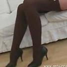 Stunning blonde in sexy beige minidress with black lingerie