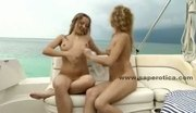 Lesbian babes naked on a yacht sucking the nipples and kissing th