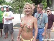 Sexy girls shaking hot tits in public