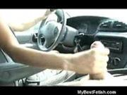 Tiffany Preston stroking a cock wile driving
