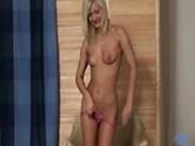 Hot Slim Blonde rubs her pussy