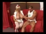 Busty doctor examines cock