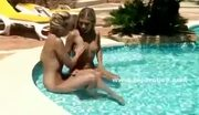 Lesbian babes naked wet their pussy in the pool water then caress