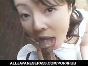 Gorgeous Japanese babe sucks on a ball sac