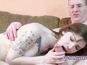 Petite tattooed redhead Indigo blowing a geek