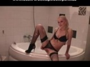 Sexy euro blonde in stockings masturbates in bathroom