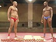 Two black gays wrestling and fucking on mats