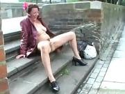Amateur exhibitionist gets nude and rude in the streets of London