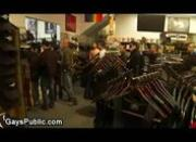 Gays fucking for the crowd in leather shop