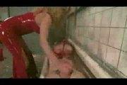 BDSM Shemale domina in red latex fucks male slave