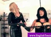 Transvestite under dominatrix power