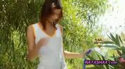 Natasha Shy shows wet tshirt in garden