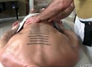 Tattooed hunk gets deep rubbing