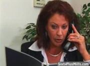 Mature hot lady masturbating in the office