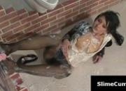 European brunette soaked in slime cum rubs her shaved pussy