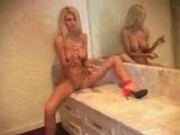 hot blond fucks her cunt with a big pink vibrator.