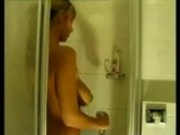 she takes a shower and his husband is filming her.