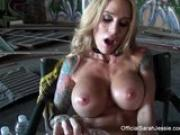 Sarah Jessie fingers her pussy
