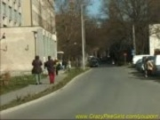 young girl peeing on street