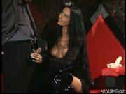 Elvira wanna be sucks a cock