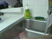 Melissa takes a foot bath