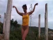 Olga alone by a tree