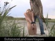 Humiliation of a blonde in leash