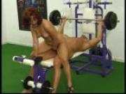 Redhead fucks bodybuilder in the gym
