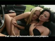 2 girls play with pussy's outside in car