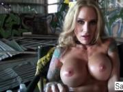 Sarah Jessie fingers her pussy and ass in an empty warehouse