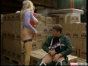 Dock worker packs her box (clip)