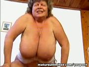 Mature shakes her big tits...