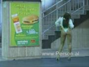 Italian woman strips at train station