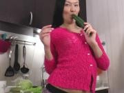 Vanessa plays with cucumber
