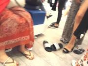 her split sexy long legs feets show at shopping