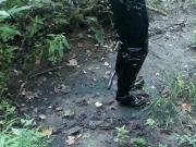 Vinyl mini skirt, thigh high boots in deep mud!