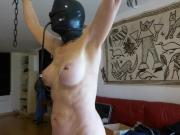 Slave is punished with fish hooks in tits