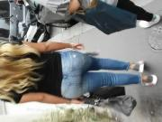 Round ass in blue jeans