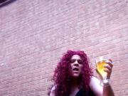Transvestite drinking piss and smoking outdoors.