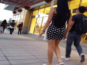 Candid voyeur hottie in tight black dress shopping mall