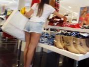 Candid voyeur teen hottie shopping short shorts