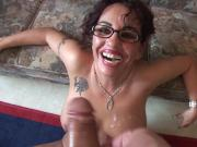 Grandma with glasses sucks some cock