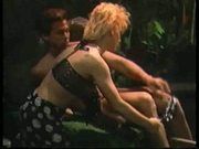 Peter North fucks blonde chick in exotic setting