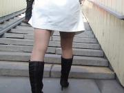 Girl in stockings going upstair
