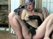 Busty babe fingers juicy pussy flaps in soft leather gloves