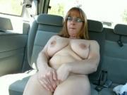 Horny MILF gets caught masturbating in the car