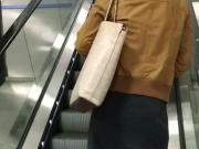 Glossy pantyhose on escalator