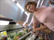 Beautiful mature lady's tits at the market