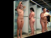 Voyeur beauty with beautiful belly takes a shower.