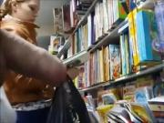 Book shop flasher close to girl